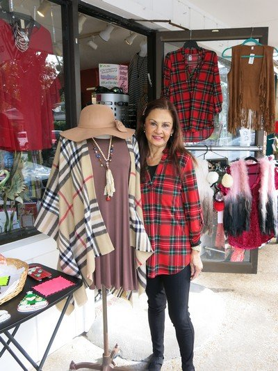 Christine Proffitt, owner of Wild & Personal Boutique, makes a commitment from her heart by donating silent auction items each year.