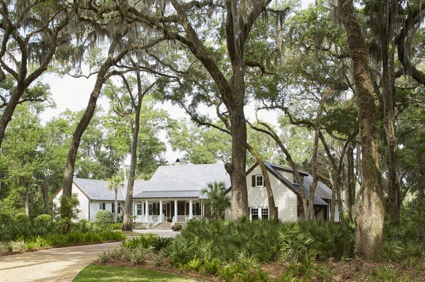 Live Oaks dramatically frame this cottage-style home in Frederica.