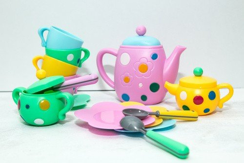 Kids tea coffee serving set, colorful cups, saucers, spoons, tea