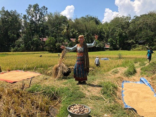 Janice in Toraja dress in rice field.