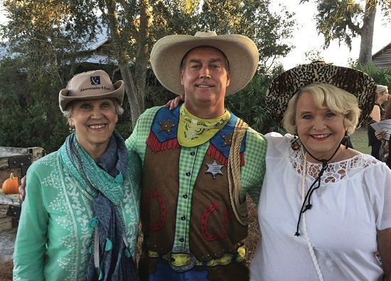 Nancy Butler, EIL Publisher David Butler, and Karen Manning at the 2016 Humane Society of South Coastal Georgia's Blue Jean Ball