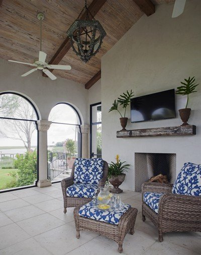 Covered screen porch with large, arched openings to optimize marsh view on Sea Island.