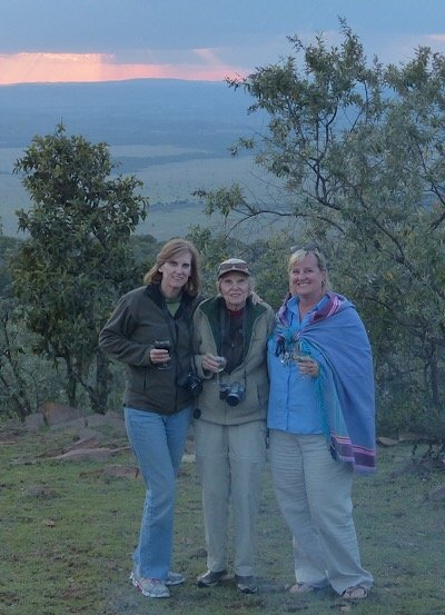 Ann with her sister and mom on safari