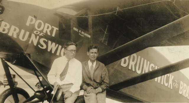 Pilot Paul Redfern (right) with Paul Varner and Redfern's plane The Port of Brunswick