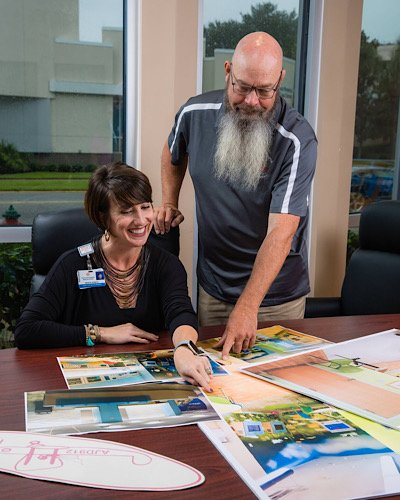 Krista Robitz and John Donohue reviewing plans for a pediatric playroom