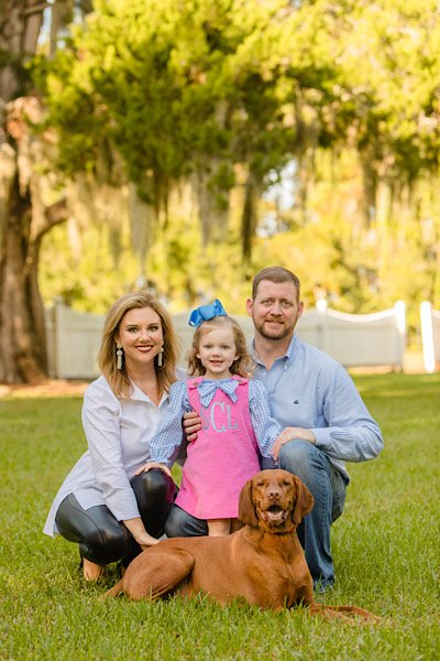 Jessica, Lanier and Michael Cannon with their dog Benjamin Franklin (Ben)