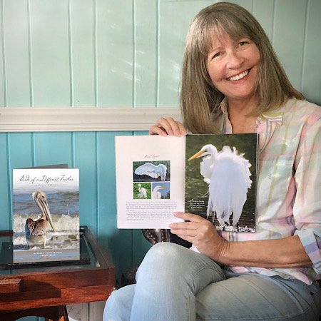 "Laurie Lohne with her book ""Birds of a Different Feather"""