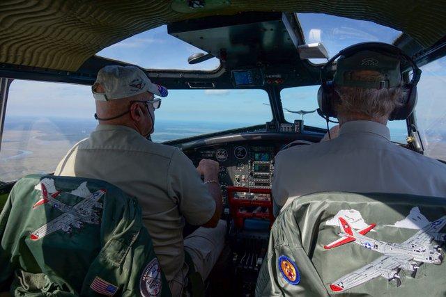 Aluminum Overcast crew in flight