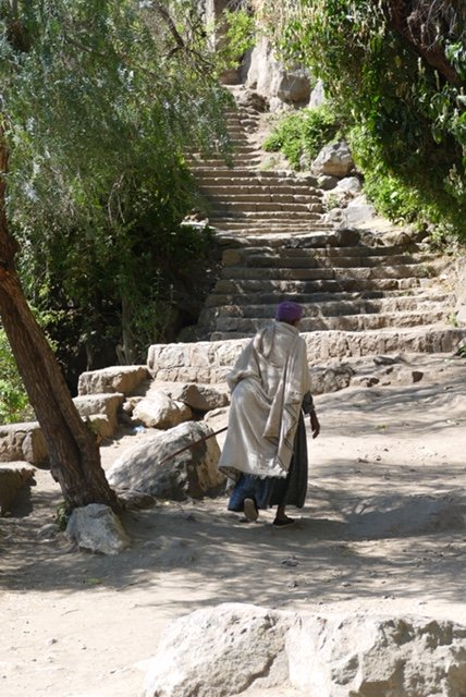 Ethiopian nun walking up steps