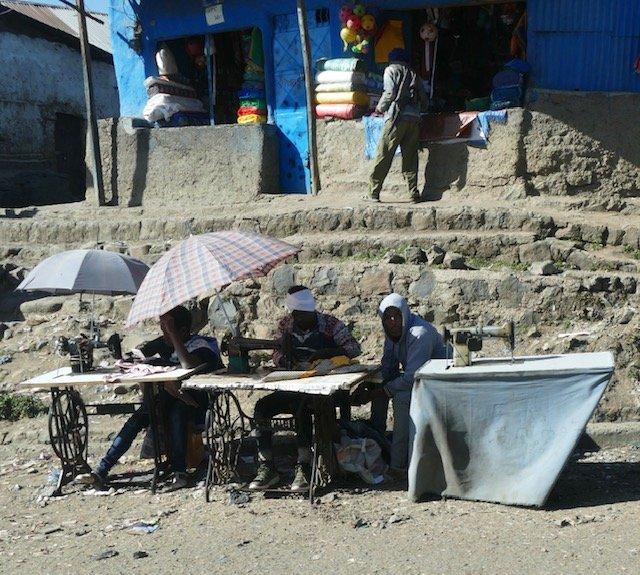 Men at sewing machines