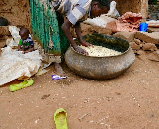 Woman mixing corn