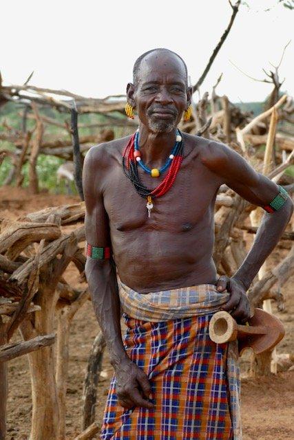 Hamar elder - scars show he has won many battles. Holding neck rest.