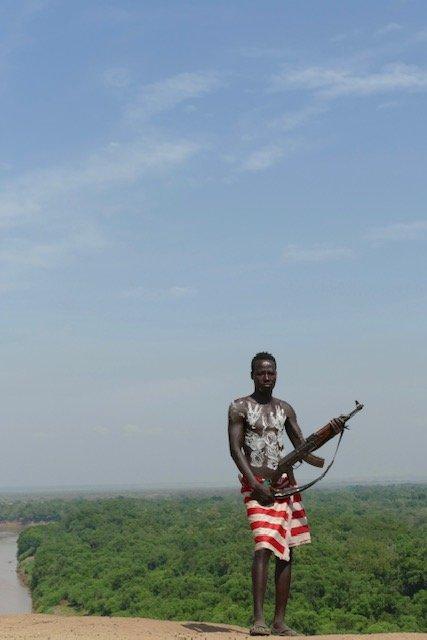 Karo man with gun