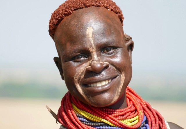 Karo tribe member colorfully adorned