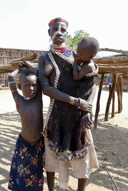 "Karo woman with children - see ""fringe"" decorating garment"