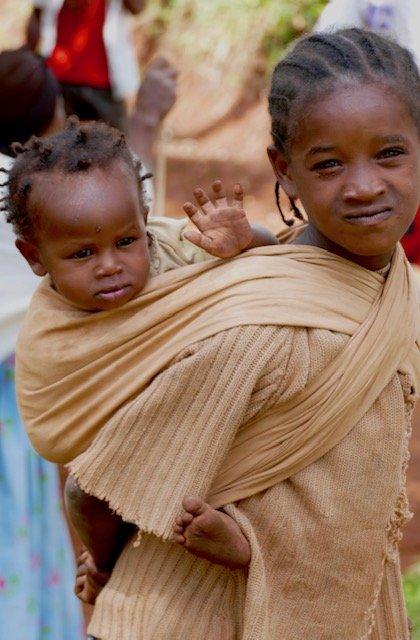 Dorze girl carrying toddler