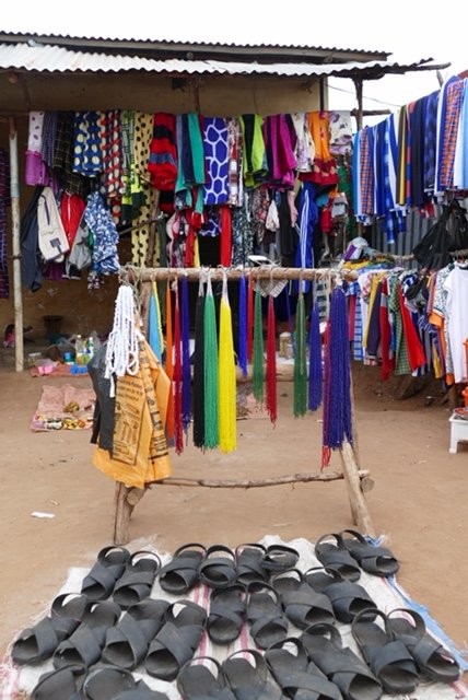 Market display of beads and rubber shoes