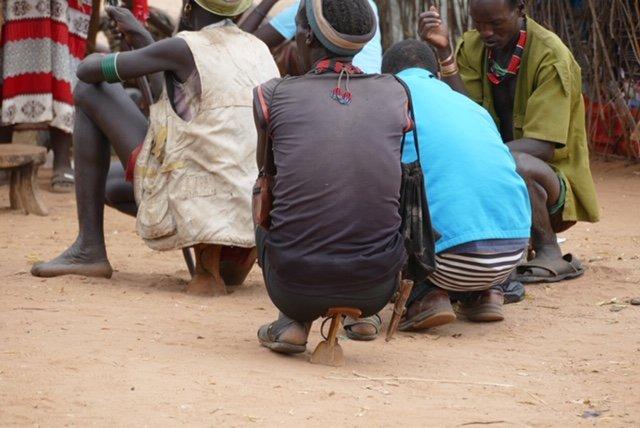 Men sitting on headrests