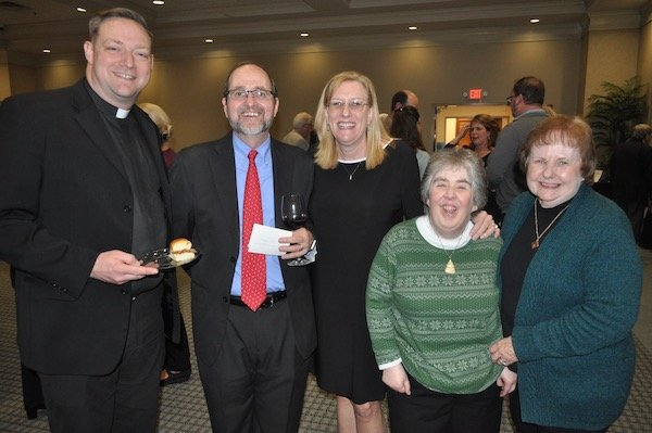 Fr. Chris Hassel, Dr. Terry and Michelle Mermann, Maureen Beerman, Mary Anne Beerman