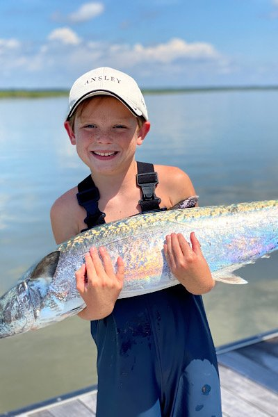 Beau Ansley on Sea Island with his big catch