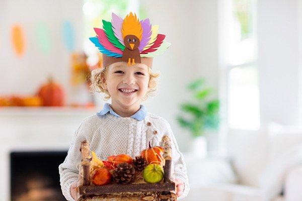 Thanksgiving boy with turkey headpiece