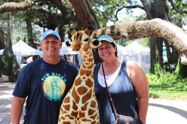 Bill and Tamara Langham with George the Giraffe
