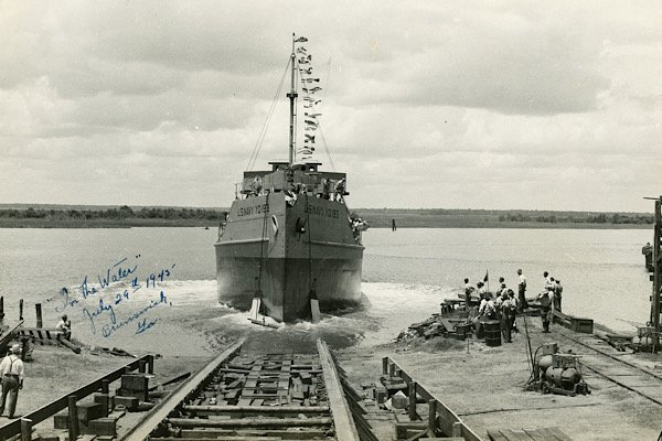 """The launch of USS YO-193, a type of tanker known as a """"yard oiler,"""" on July 29, 1945, following its christening at Brunswick Marine."""