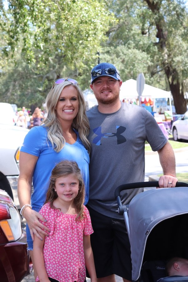 Linsey and Tyler Caheely with Aubrey (and a sleeping Carter)