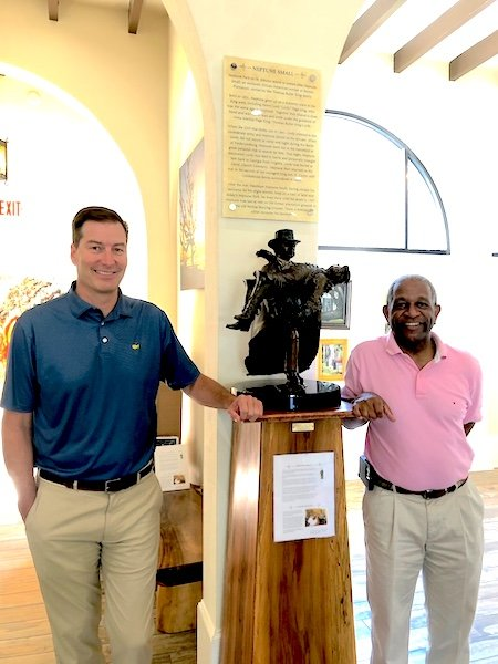 Golden Isles CVB President & CEO Scott McQuade and artist Kevin Pullen with Pullen's sculpture of Neptune Small