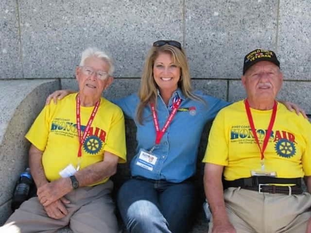Trip Coordinator and co-founder of Coastal Honor Flight, Chandra Kendall and her veteran companions on an earlier mission