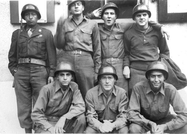 "Frank Giacobbe (bottom, left) and his ""band of brothers,"" included a Navajo soldier, Irish, Italian, English and Jewish friends. ""We knew everything about each other,"" he recalls."