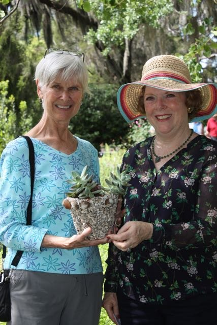 Dorris Burton, the first winner of the tabby house treasure hunt, accepting her award from Anne Aspinwall
