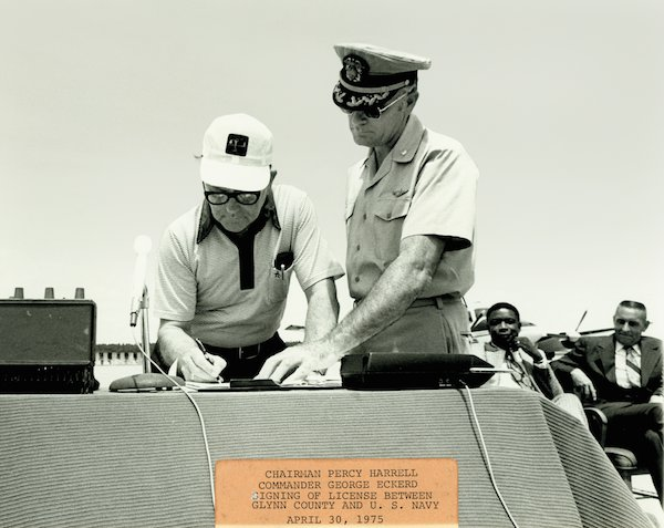 Chairman Percy Harrell, Commander George Eckerd Signing License Between Glynn Co. & US Navy, April 30, 1975