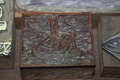 Carved wood block with shrimp boat
