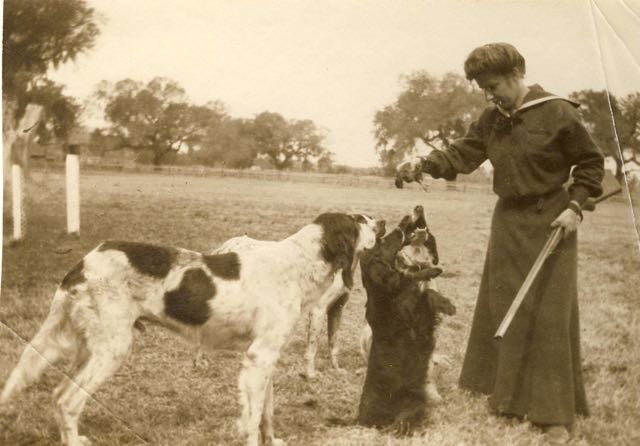 Ophelia Dent with her shotgun, dogs, and rice bird