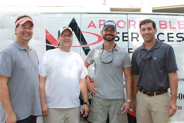 Operation Bed Spread Board members Joey Baldwin and Dan Meyers with founder Rees Carroll, and Jimmy Seaman of A-1 Cleaning & Restoration