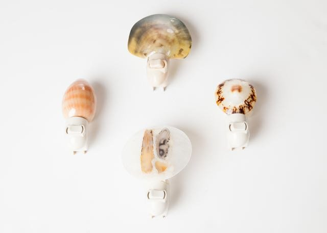 Let there be light…stylishly! These cute handcrafted seashell nightlights from Lamp and Shade Collection light your guests' way along unlit halls or dark bathrooms and avoid the tackiness of a harsh, industrial nightlight.