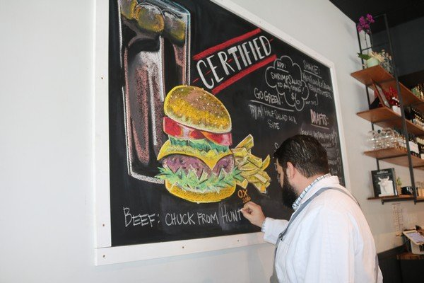 Chef Dave Carrier at the chalkboard at CBBSSI