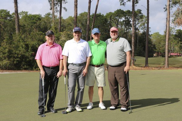 Varsity Supply Team: Mark Bruce, Dale McNabb, Bert Davitte, Tom Smith