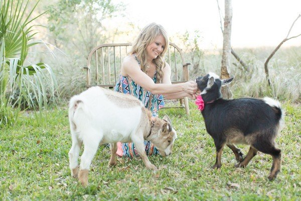 Christie Richardson with dwarf Nigerian goats Billy and Lillie