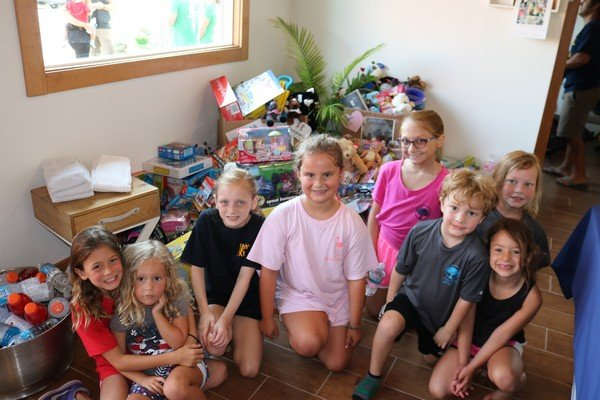 Miss Charlie Young and Chase Busby and their friends with toys collected for Wolfson's